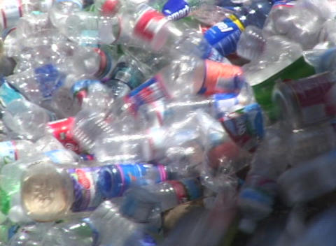 Thousands of plastic bottles pour out of a container in a recycling center Footage