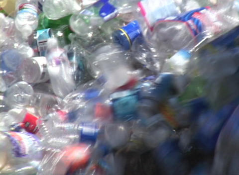 Thousands of plastic bottles pour out of a container in a... Stock Video Footage