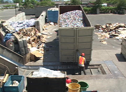 Workers unload aluminum cans at a recycling center Stock Video Footage
