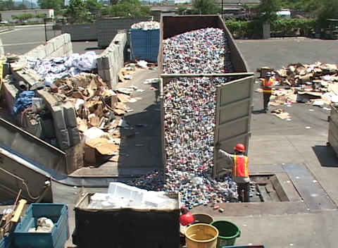 Workers unload aluminum cans at a recycling center Footage