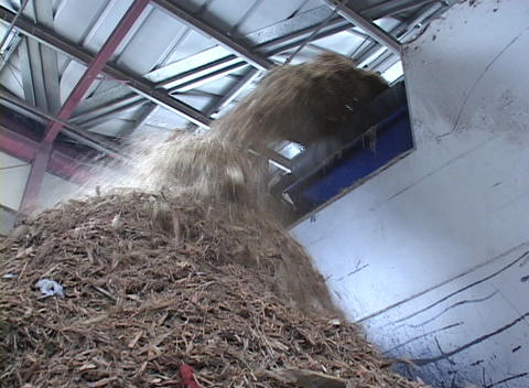 Recycled materials are poured into a pile Stock Video Footage