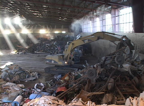 An industrial claw picks up recycling materials Footage
