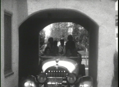 Family driving 1920's automobile in this home movie Stock Video Footage