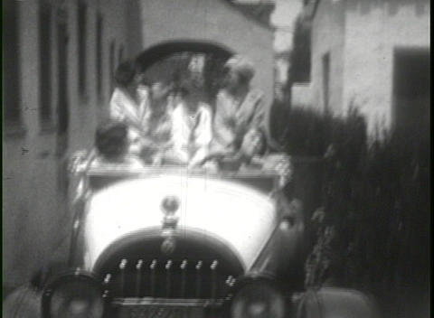 Family driving 1920's automobile in this home movie Footage