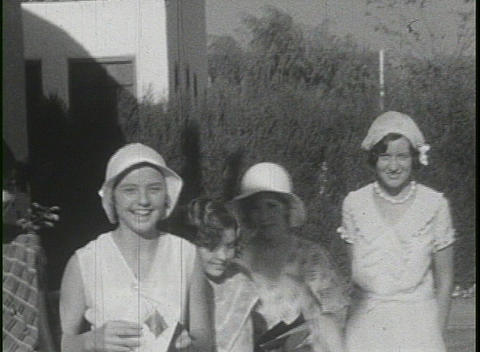 Flapper like girls pose for the camera in this 1920's shot Stock Video Footage