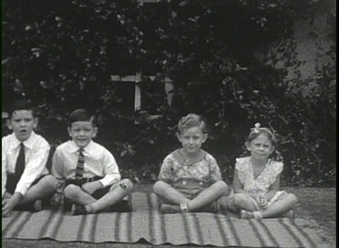 Home movies from the 1920's show portraits of many people Stock Video Footage