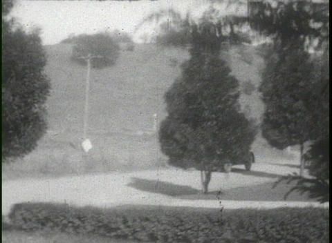 1920's footage of people driving cars and having a... Stock Video Footage