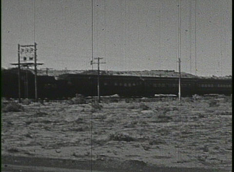 A steam train passing in this home movie Stock Video Footage