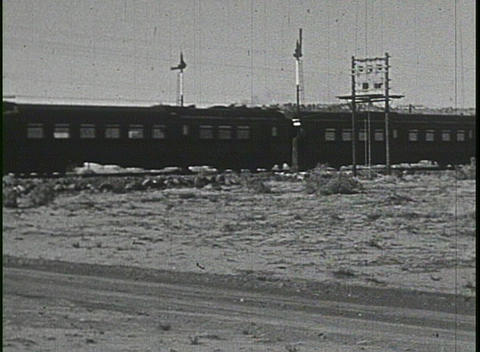 A steam train passing in this home movie Footage