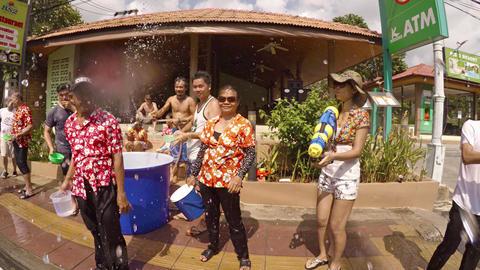 Splashing strangers and applying powder at Songkran Festival. Thailand Footage
