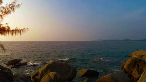 Late Afternoon Sun over a Rocky Tropical Seascape. Video 4k 2160p Footage