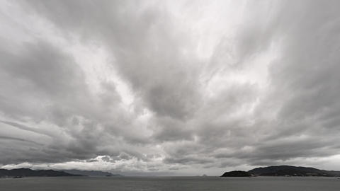 Abstract Timelapse Clip of Dense Clouds Scuttling across a Seascape Footage
