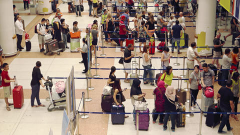 Long lines at ticketing counters at Phuket International Airport in Thailand Footage
