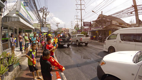 Strangers splashing each other with water at Songkran festival. Thailand Footage