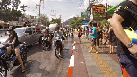 Celebrants dancing and splashing in streets at Songkran Festival. Thailand Footage