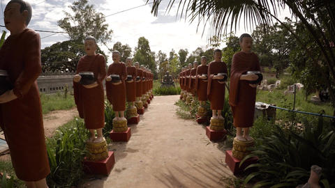 Rows of of sculptures portraying Buddhist monks. Cambodia Footage
