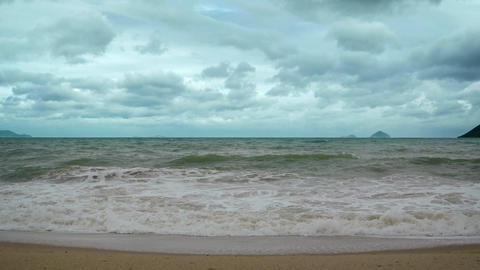Small Waves Washing a Sandy Beach on a Cloudy Day. Footage UHD Footage
