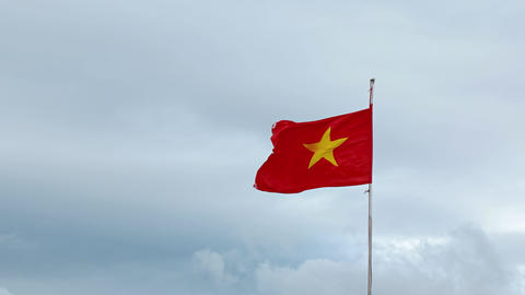 Vietnamese National Flag Flapping on a Cloudy Day. UltraHD video Footage