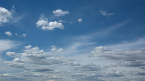 Puffy Clouds Building and Drifting in the Sky. in Timelapse Footage