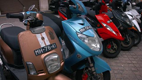 Long row of parked motor scooters in urban Macau. Footage UHD Footage