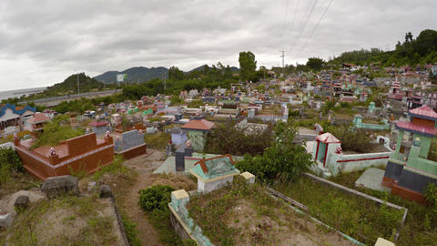 Buddhist cemetery overlooks highway from hillside in Nha Trang. UHD Footage