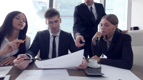 Business people discuss documents Footage