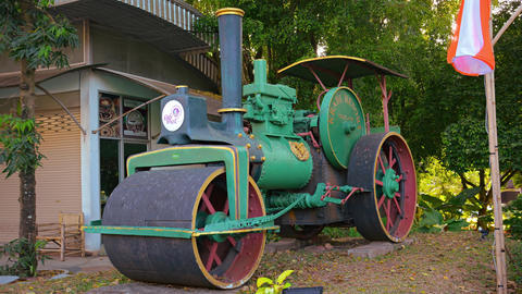 Antique steam roller on static display at a public park Footage