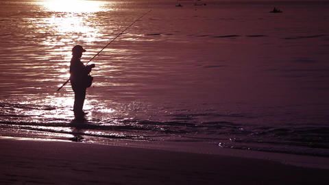 Local fisherman on the sandy beach during sunset Footage