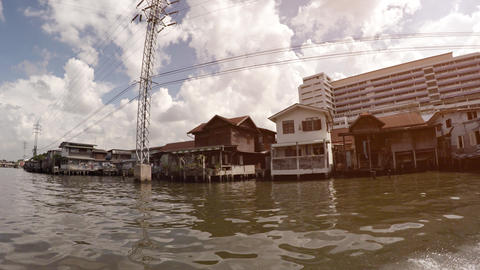 Poor house on the water. River in Bangkok. Thailand Footage