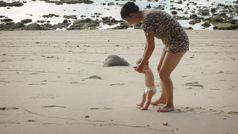 Mother Playing with her Happy Baby on the Beach. Video 4k Footage
