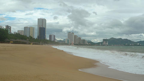 Waves on a Beach under Highrise Buildings of Nha Trang. Vietnam Footage