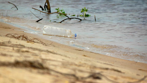 Plastic Soda Bottle Floating on the Beach. Video 4k Footage