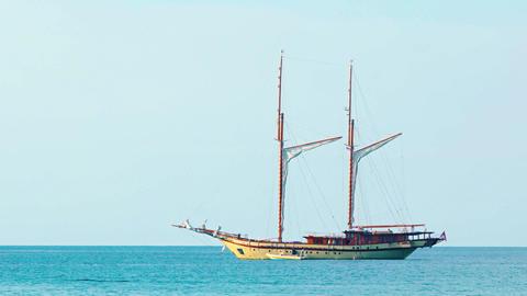 Wooden sailboat under bare poles - gaff topsail schooner Footage