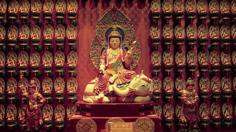 Many religious statues at the Buddha Tooth Relic Temple in Singapore Footage