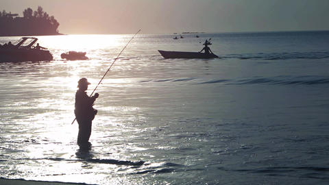 Fisherman on the beach. Evening time. UltraHD 2160p 4k video Footage