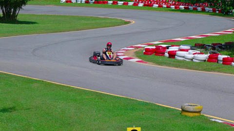 Tourists ride on an asphalt carting track. UltraHD 2160p 4k video Footage