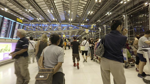 Travellers scurrying through checkin area at Suvarnabhumi International Airport Footage