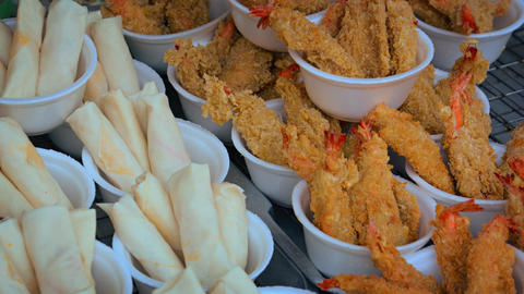 Prawns and Egg Rolls for Sale at an Open Market. Video 4k Footage