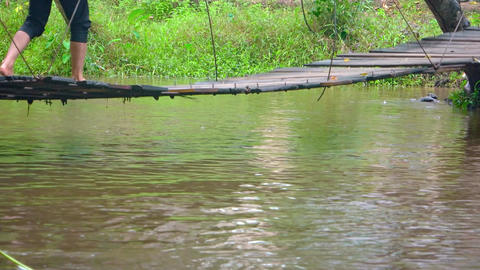 Old suspension bridge over river close-up. Phnom Koulen National Park Footage