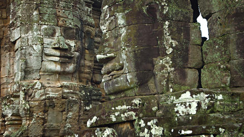 Stone faces on the walls of an ancient temple. Bayon temple. Cambodia Footage