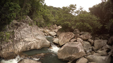 Wild Mountain Creek Tumbles along Rocky Course in Vietnam. with Sound Footage