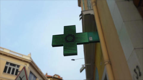 Pharmacy Neon Green Cross Sign Footage