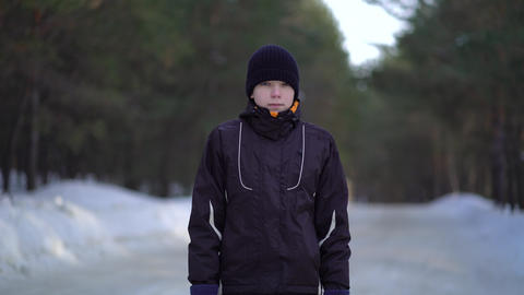 Portrait of Handsome Young Male Athlete Jogging in Winter Woods Live Action