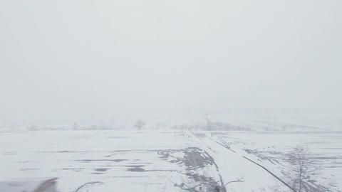 Japanese train window in winter. Countryside snow landscape GIF
