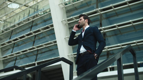 Closeup businessman talking phone outside. Businessman checking time on watch Live Action