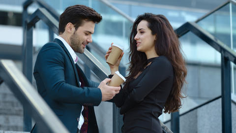 Closeup business couple standing with coffee. Business man and woman talking Live Action