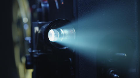 A projector lens with a ray of light close-up Live Action