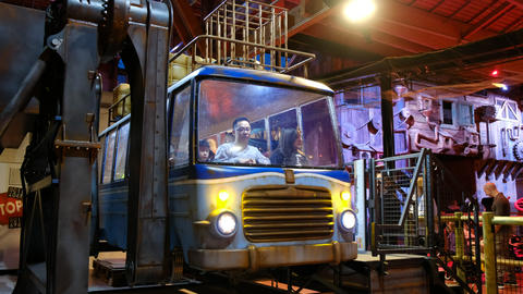 indoor carnival theme park - An asiatic family on crazy flying bus ride at Luna Live Action