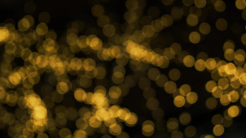 Blurred yellow Christmas illumination. Abstract bokeh particles background Live Action