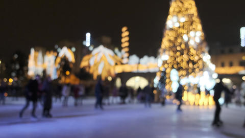 Ice skate during Christmas holidays blurred. People skating on an outdoor Live Action